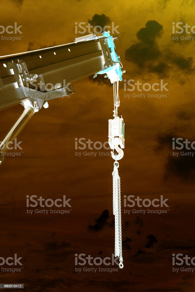 Powerful industrial crane against yellow sky stock photo