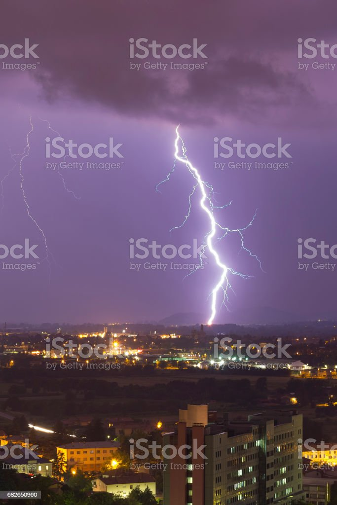 Powerful lightning bolt behind the city stock photo