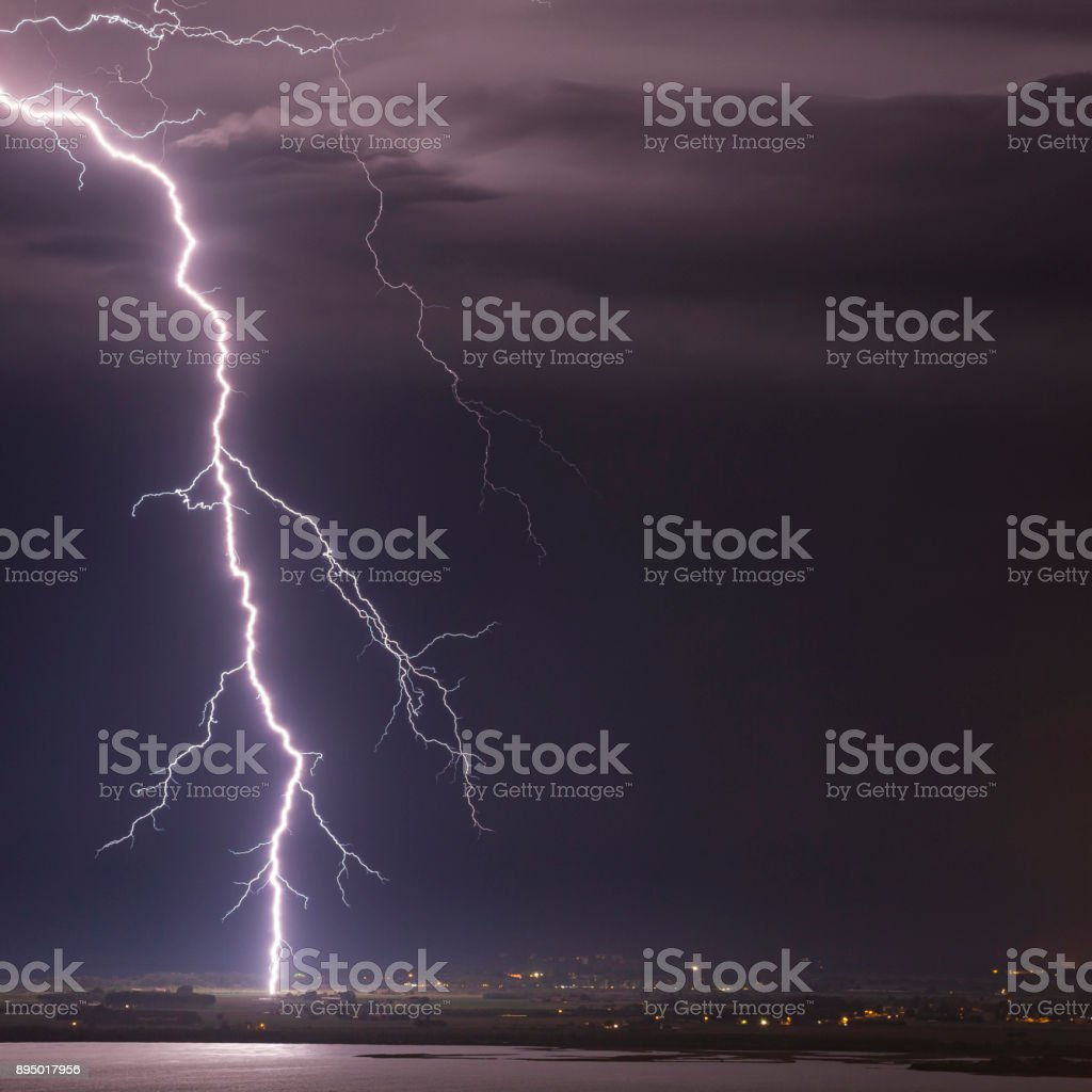 Night shot of a majestic lightning strike over the Adriatic sea, Italy