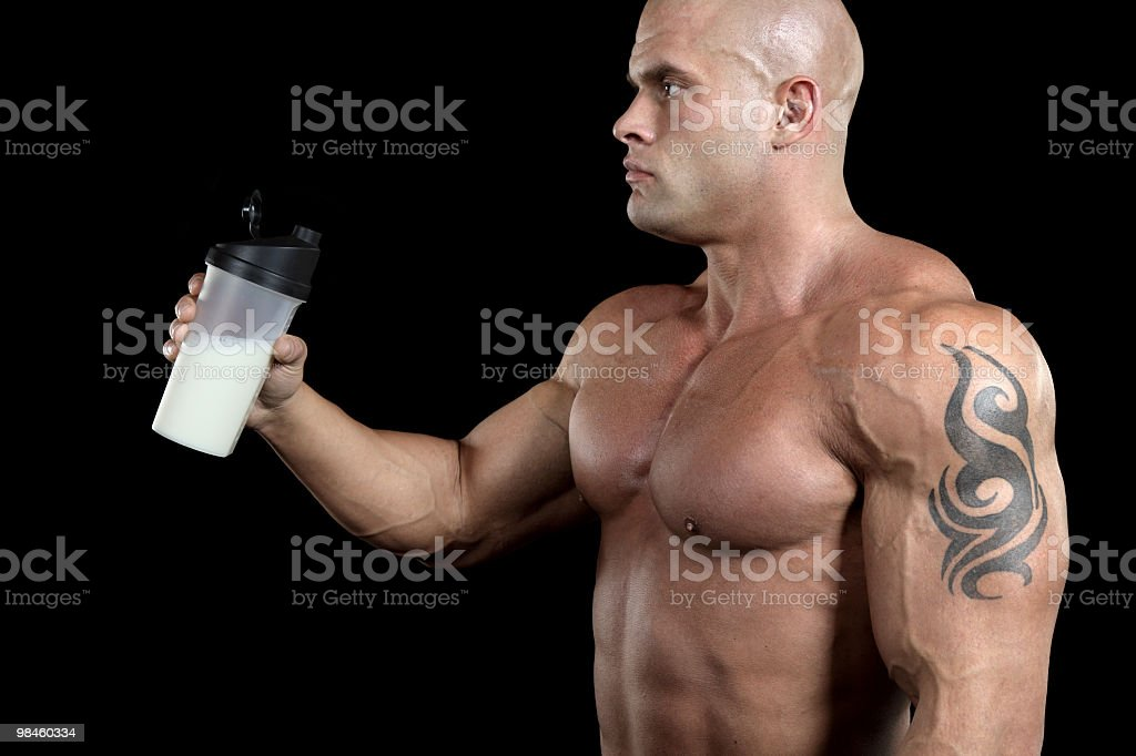 Powerful male with protein shake royalty-free stock photo