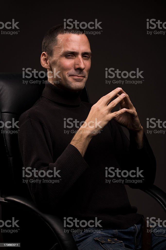 Powerful man sitting in chair royalty-free stock photo
