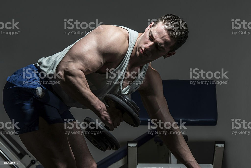 Powerful muscular man lifting weights on black background royalty-free stock photo