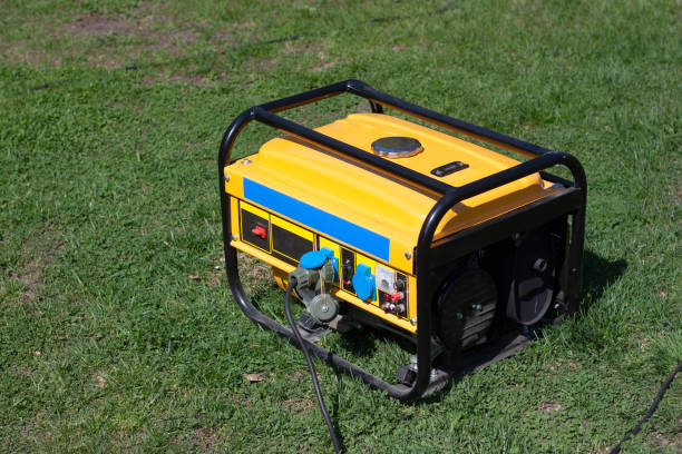 Powerful portable gas or diesel generator to provide electricity. Standing on the grass stock photo