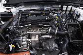 istock Powerful sports car engine. Internal design of vehicle engine. Car engine part. Under the hood of modern powerful car engine. 1195603997