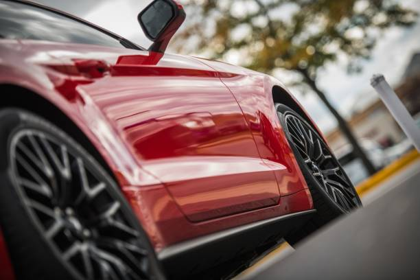 Powerful Sporty Car Powerful Sporty Car. Red Performance Vehicle with Sport Grade Alloy Wheels sports car stock pictures, royalty-free photos & images
