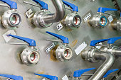 istock Powerful steel ball valves mounted on a metal wall 886474634