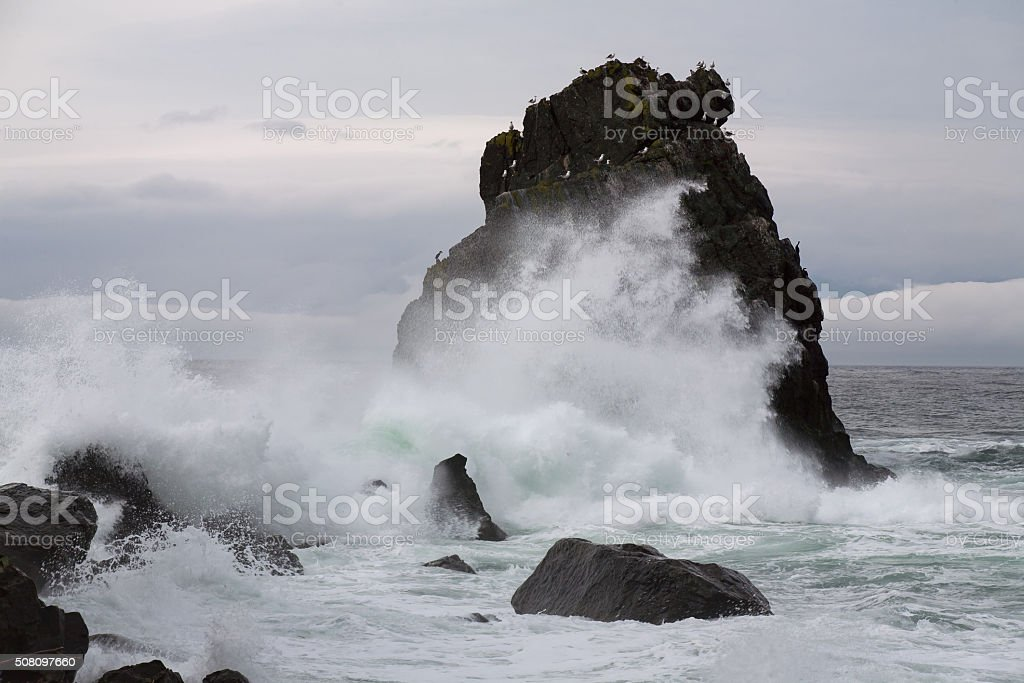 Powerful surf beating against the cliffs. stock photo