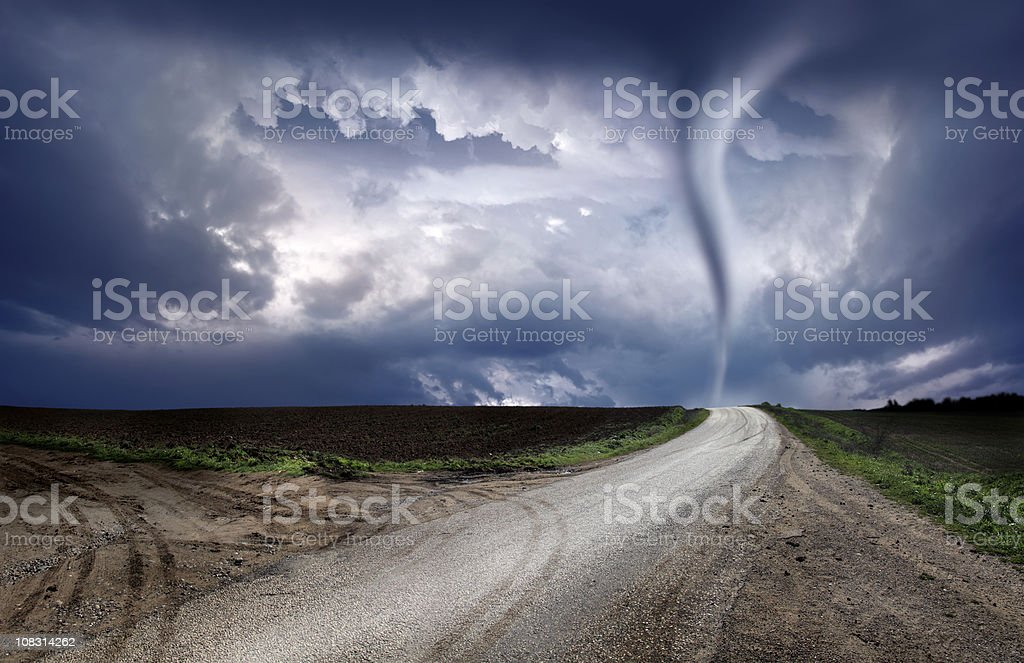 powerful tornado and road stock photo