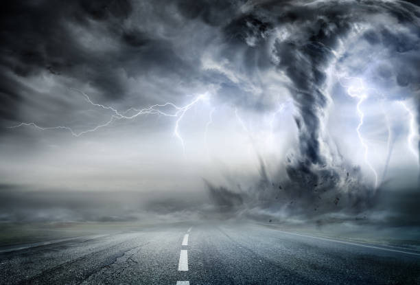 Powerful Tornado On Road In Stormy Landscape stock photo