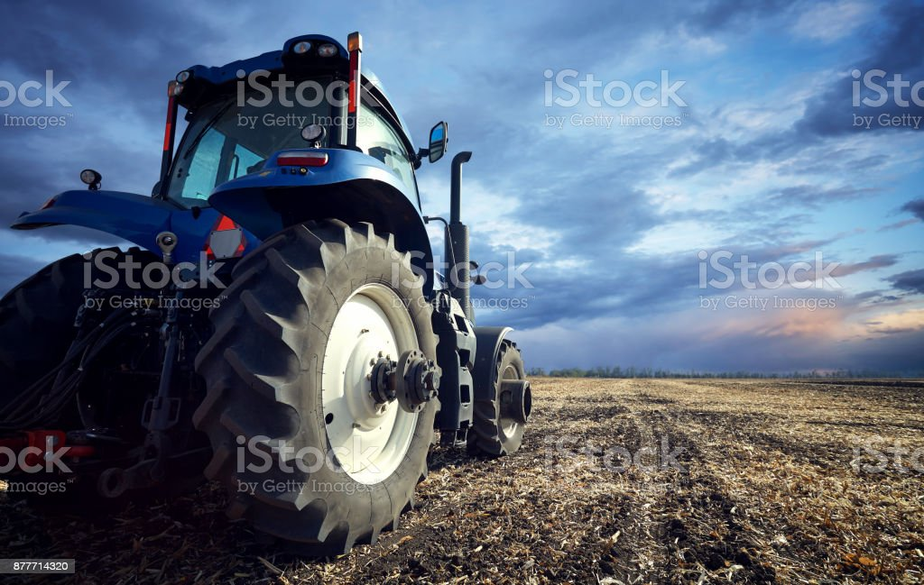 A powerful tractor handles the ground stock photo