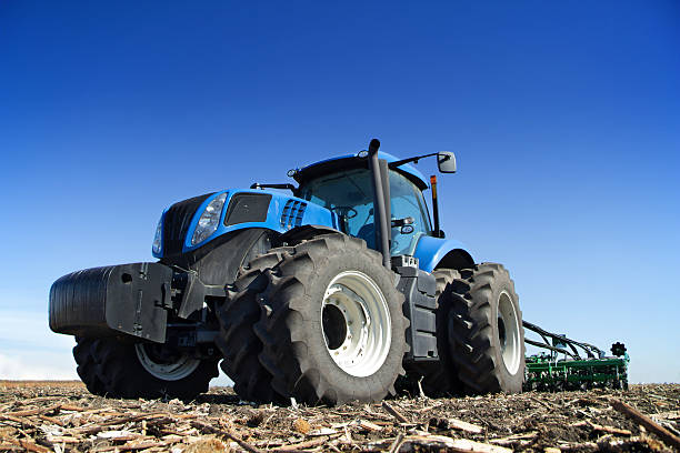 Powerful tractor working in the field stock photo