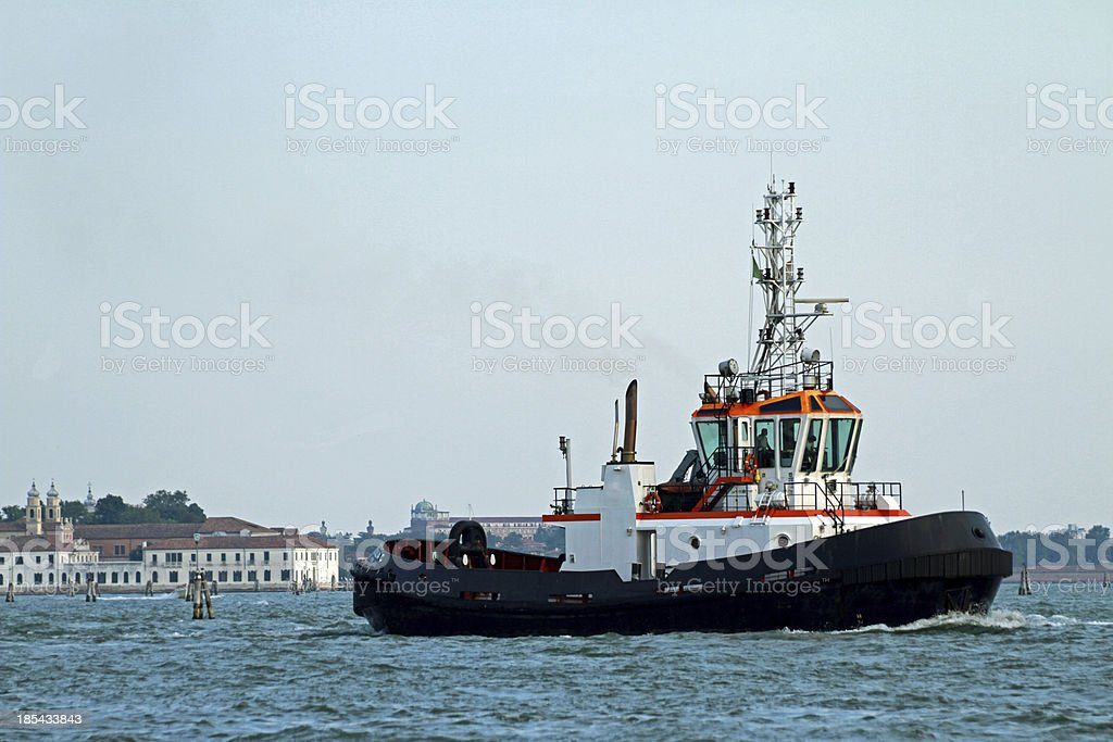 powerful tug boat to bring out from the port royalty-free stock photo