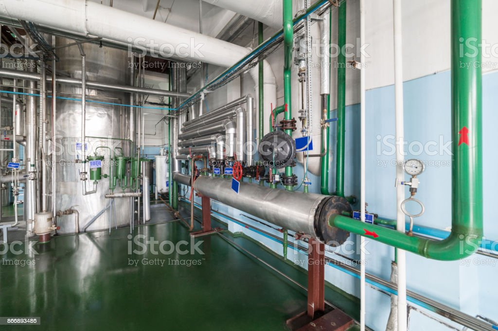 Powerful valves on the steam pipelines stock photo