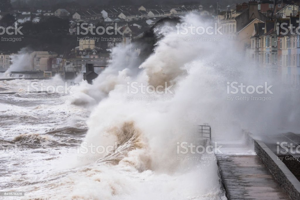 Powerful waves engulf rainway line at Dawlish during storm stock photo