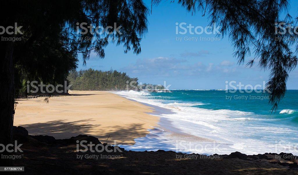 Powerful waves flow onto sand at Lumahai Beach, Kauai stock photo