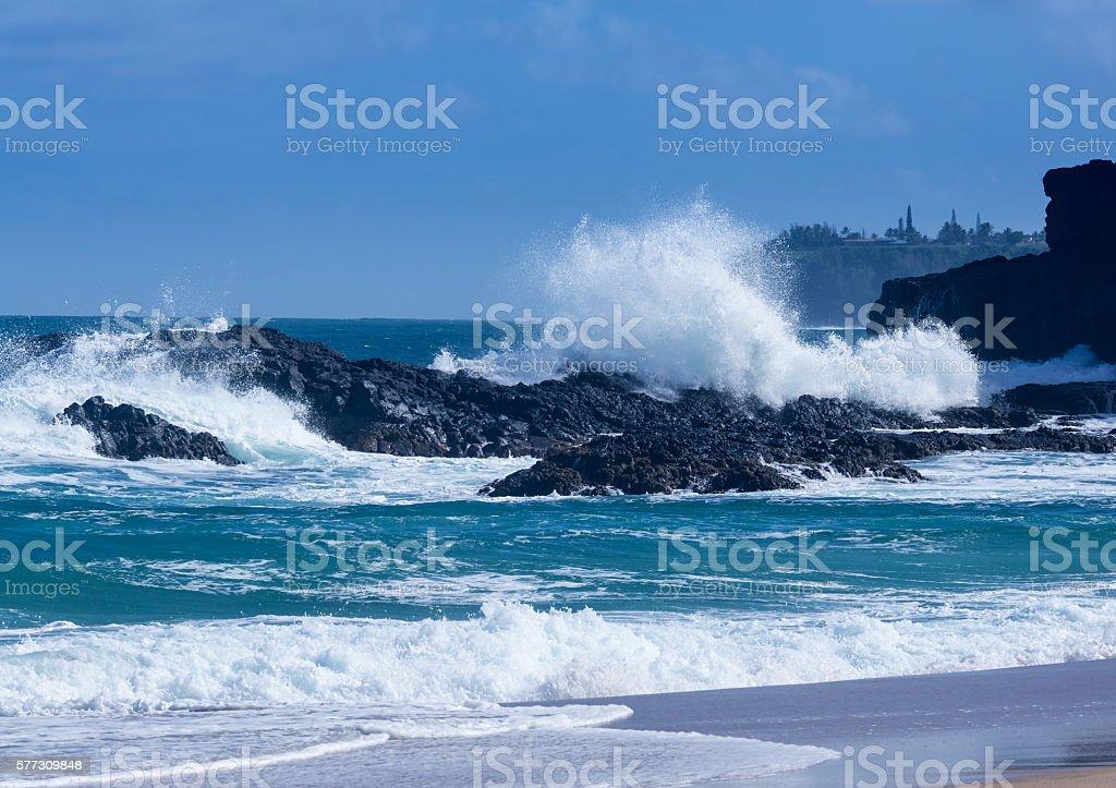 Powerful waves flow over rocks at Lumahai Beach, Kauai stock photo