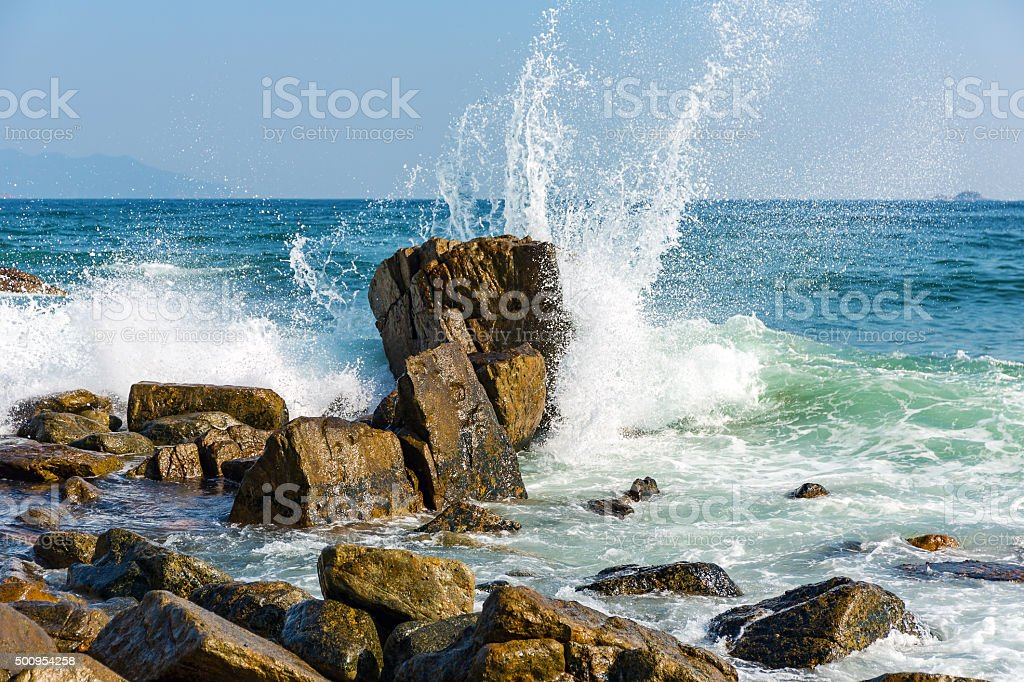 Powerful Waves on a rocky beach stock photo