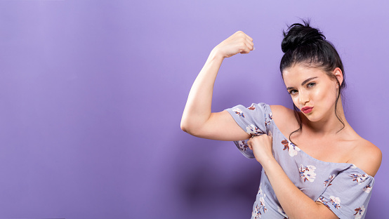 Powerful Young Woman In A Success Pose Stock Photo - Download Image Now