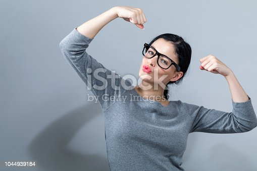 istock Powerful young woman in success pose 1044939184