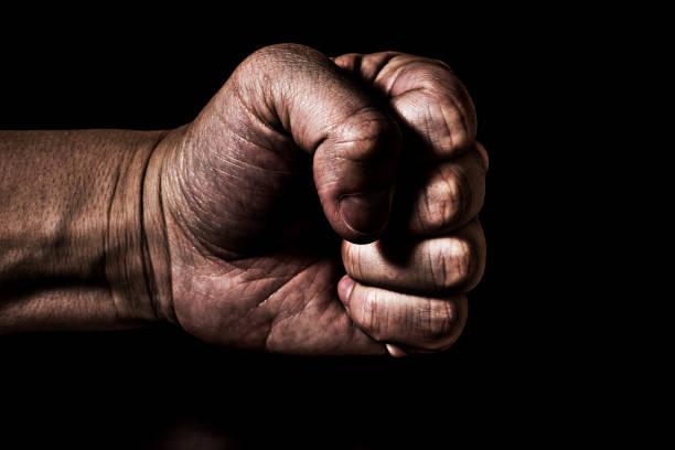 Powerfully grasped fist stock photo