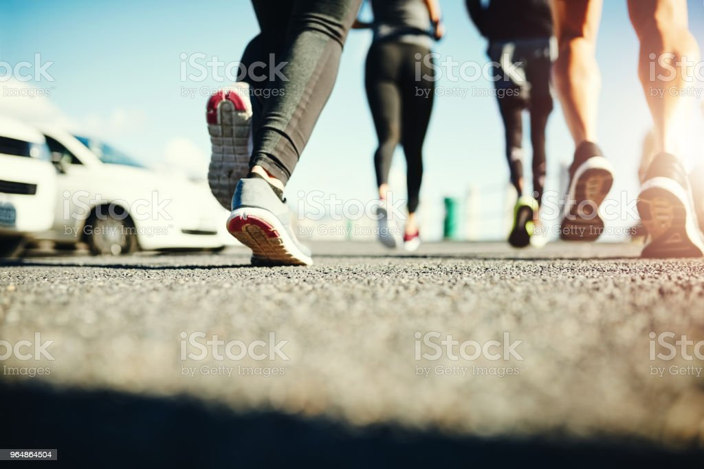 Powering through their group run royalty-free stock photo