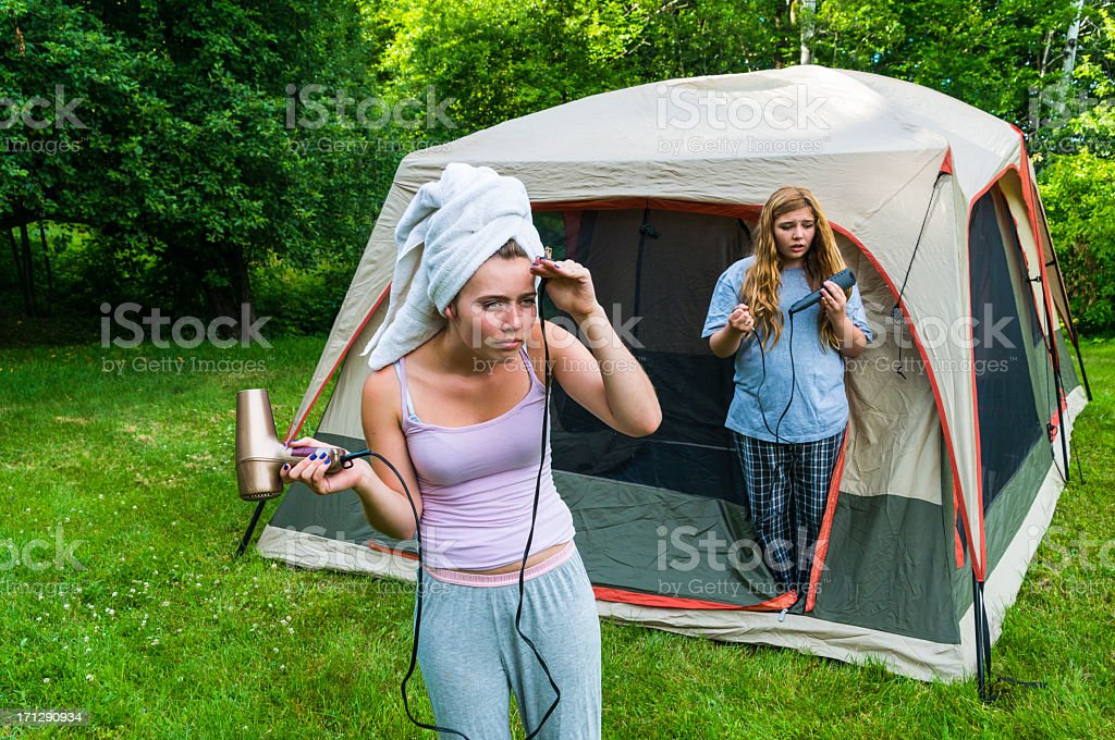 Powerless girls in camping with hairdryer and flat iron. royalty-free stock photo
