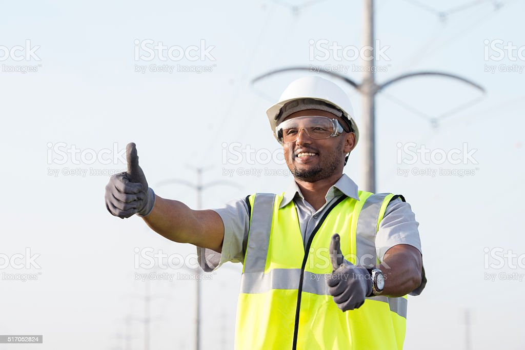 Powerline technician with thumbs up. stock photo