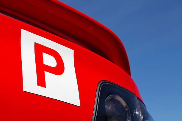 P-Plate P-Plate on rear of red car letter p stock pictures, royalty-free photos & images