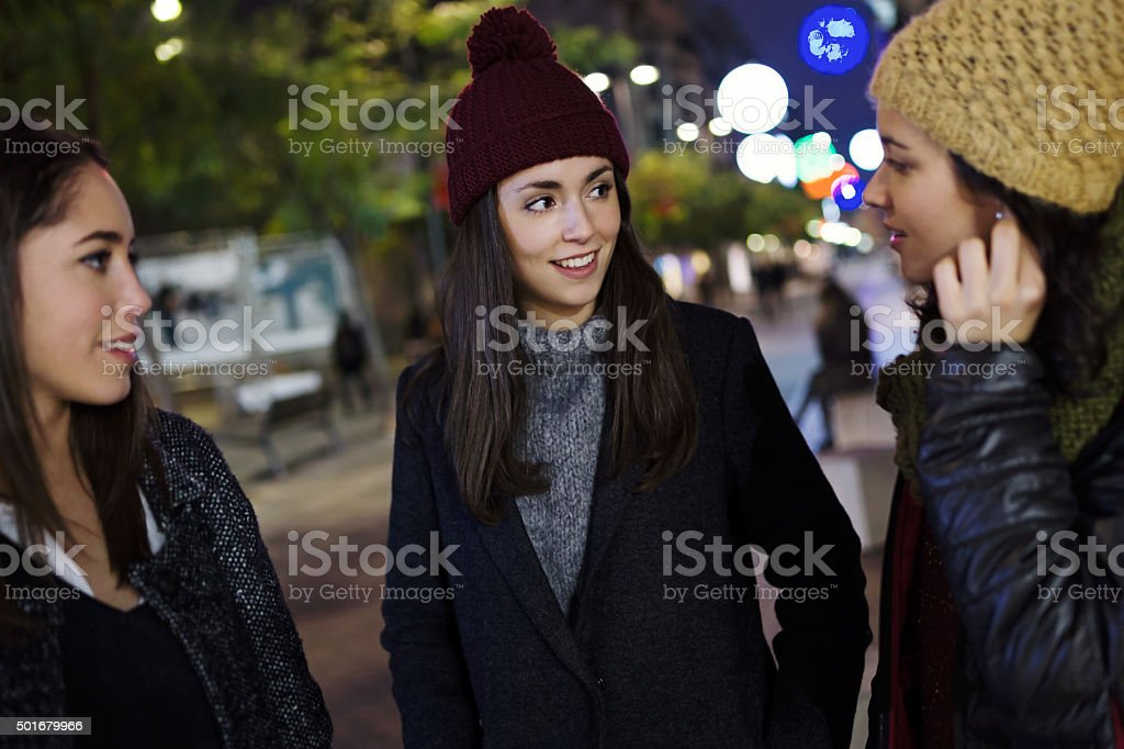 PPortrait of three young beautiful women talking and laughing. stock photo