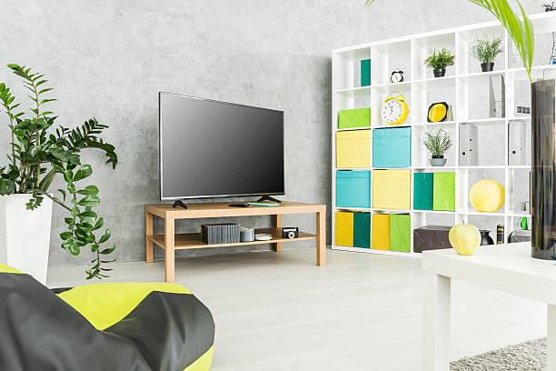 practical and comfy modern living space - uhrenhalter stock-fotos und bilder