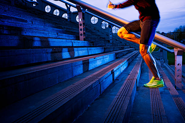 practice, close up of young man running up the stairs - extreme sports stock photos and pictures