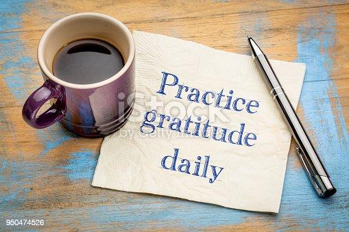 Practice gratitude daily reminder - inspirational handwriting on a napkin