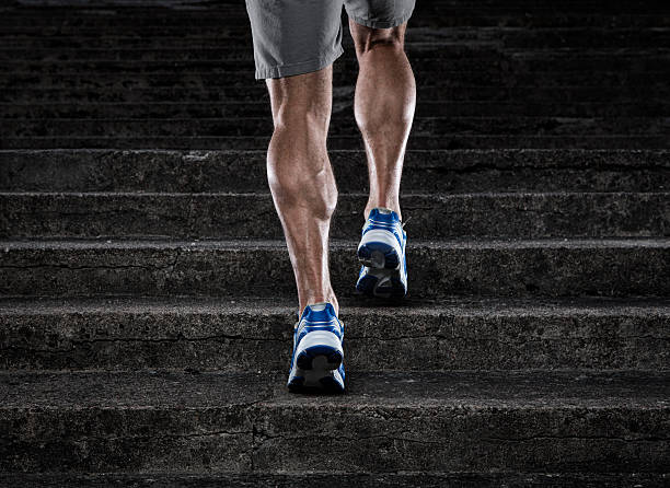 Practice Close up of young man running up the stairs calf stock pictures, royalty-free photos & images