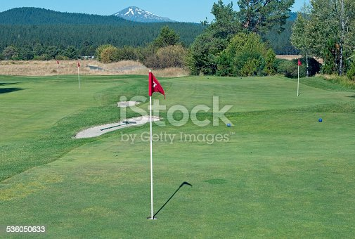 Practice putting greens at golf course in central Oregon with Mount Bachelor in background