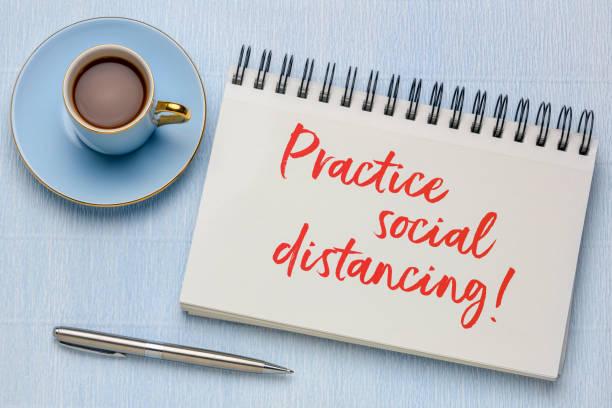 practice social distancing text in art sketchbook stock photo