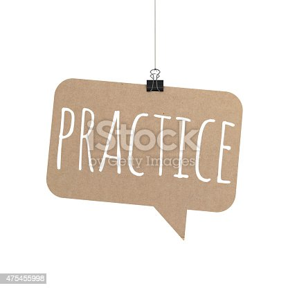 A  3D representation of a speech bubble hanging on a plain white background. The speech bubble is hanging from a binder paper clip that is attached to a piece of string. The bubble has a cardboard texture. The background is pure white. written on the speech bubble in white text is Practice