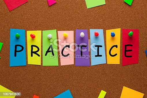 Practice word on colorful stickers pinned on cork board. Business concept.