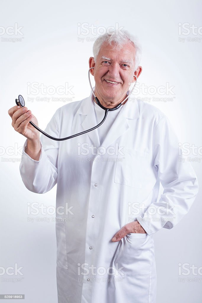 Practiced doctor with stethoscope stock photo
