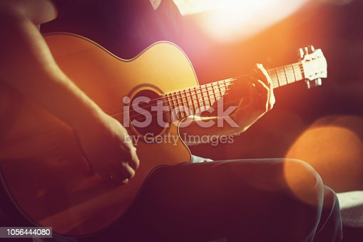 Practicing acoustic guitar