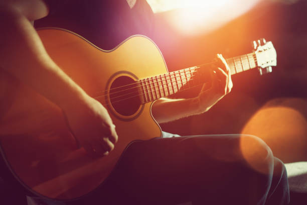 practicing acoustic guitar - music style stock pictures, royalty-free photos & images