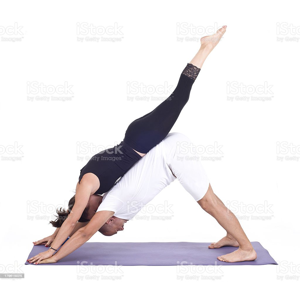 Practicing Acro Yoga /  Down Dog Pose Adho Mukha Svanasana royalty-free stock photo