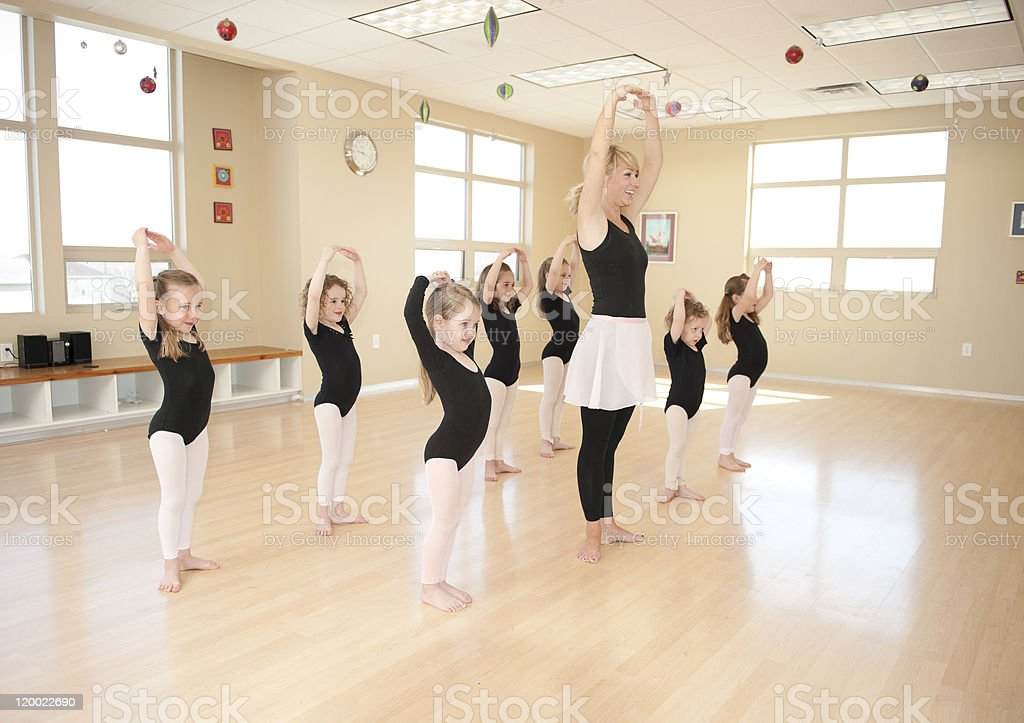 Practicing ballet for little girls stock photo