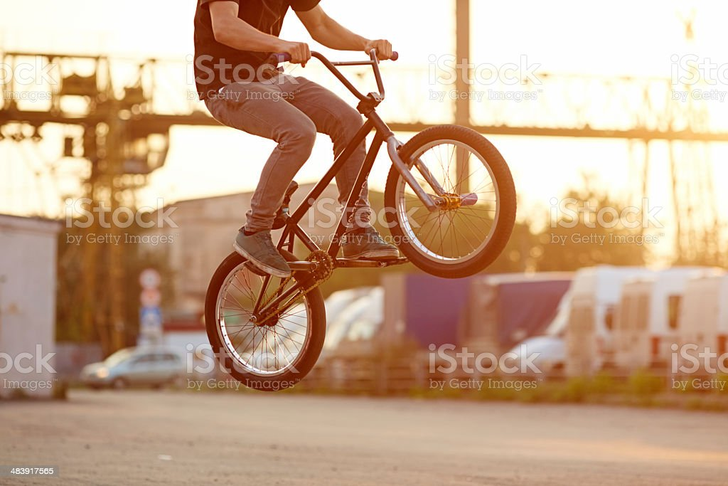 Street stunt person ahowing hop