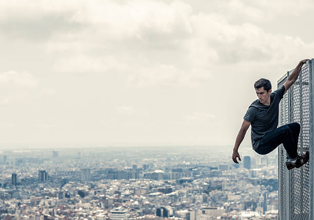 practicing parkour in the city - daredevil stock pictures, royalty-free photos & images