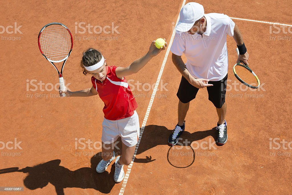 Practicing tennis service stock photo