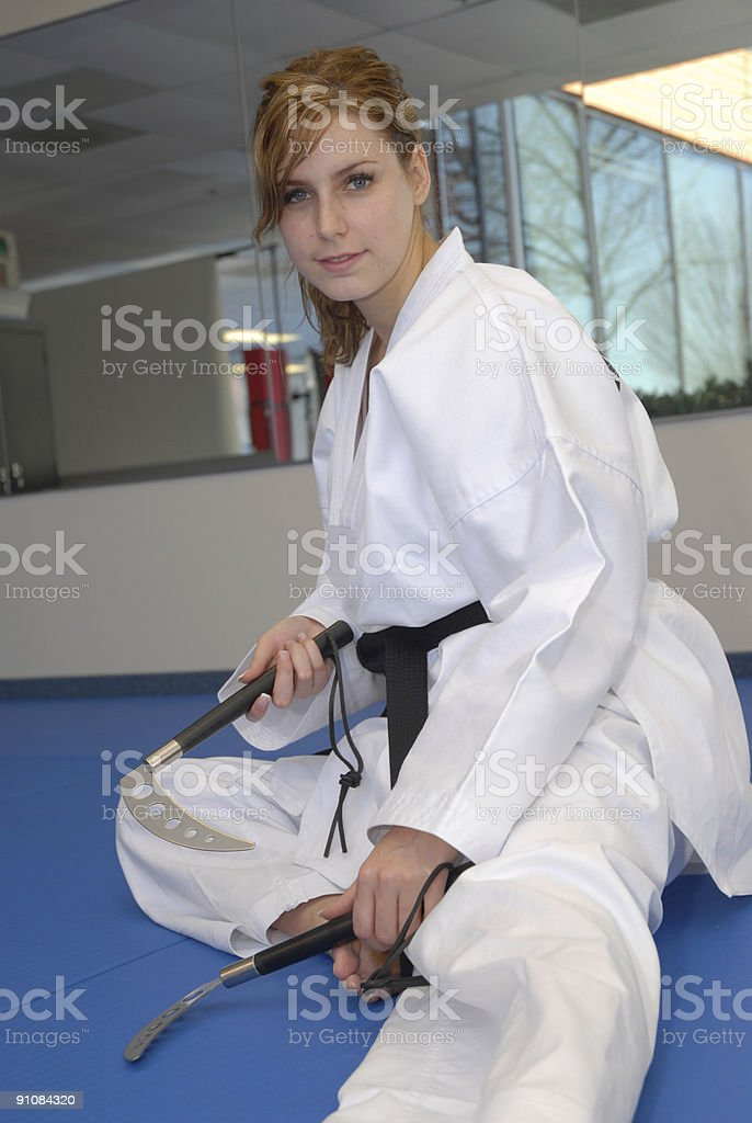 Practicing with sais in the dojang stock photo