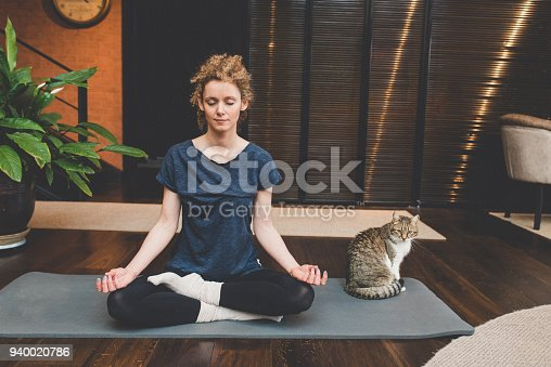 istock Practicing yoga at home 940020786