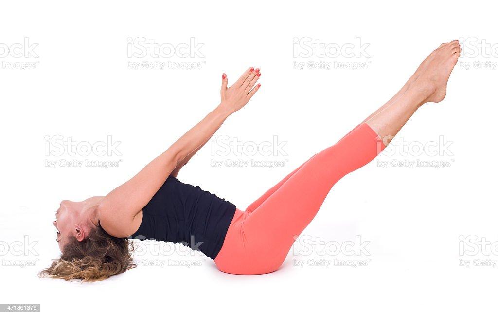 Practicing Yoga exercises / Boat Pose - Navasana royalty-free stock photo