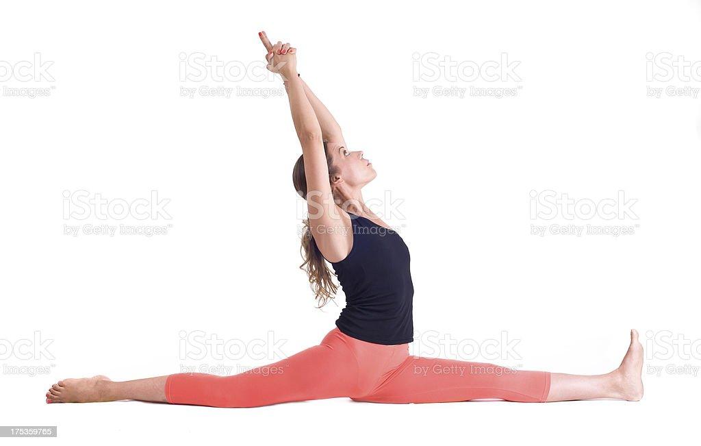 Practicing Yoga exercises / Monkey Pose - Hanumanasana stock photo
