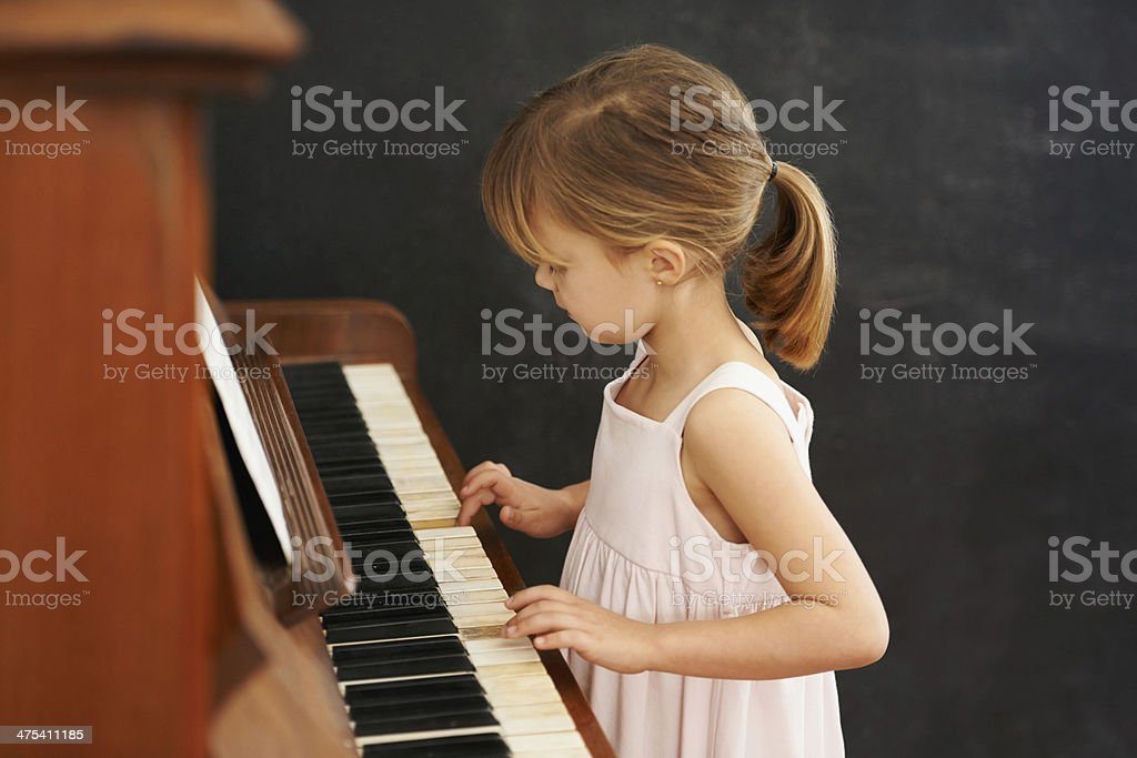 Practising for her recital stock photo